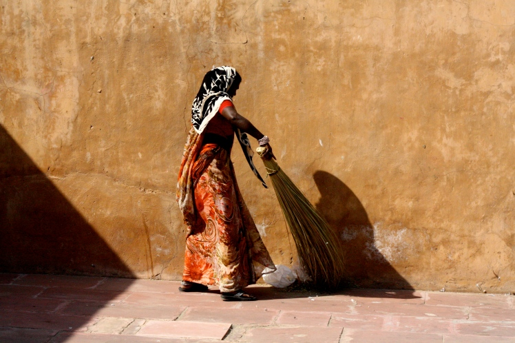 India - woman sweeping